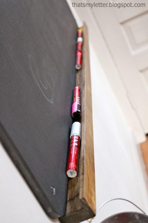 chalkboard with storage ledge
