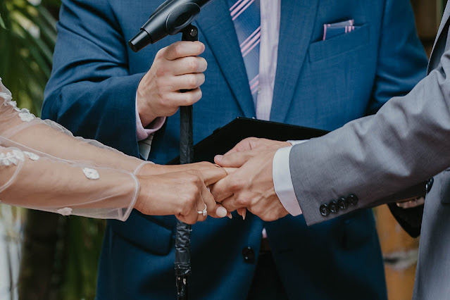 Closeup of Bride and Groom holding hands during vows The Manor on St Lucie Crescent Wedding captured by Stuart Wedding Photographer Heather Houghton Photography