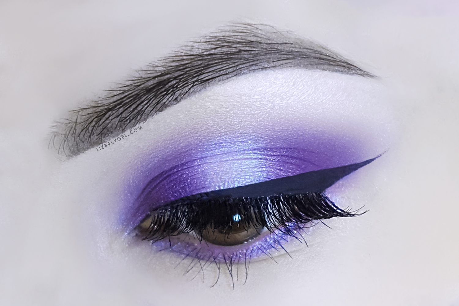 a clos eup picture of an eye with a beautiful smokey eye look
