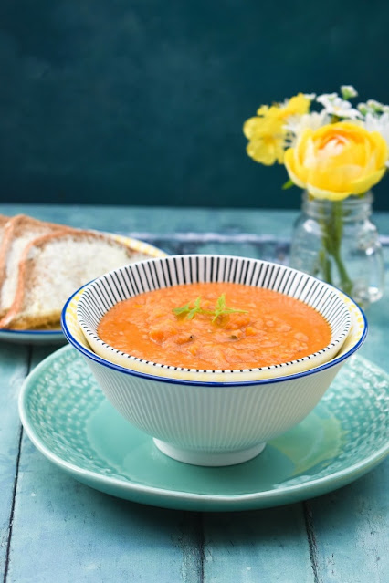Slow cooker lentil and peanut butter soup, served with buttered brown bread
