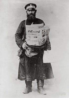 https://commons.wikimedia.org/wiki/File:Russian_newspaper_vendor.jpg