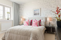 Floral pink cushions for bright bedroom decor ideas with gray floral wallpaper curtains and beige duvet