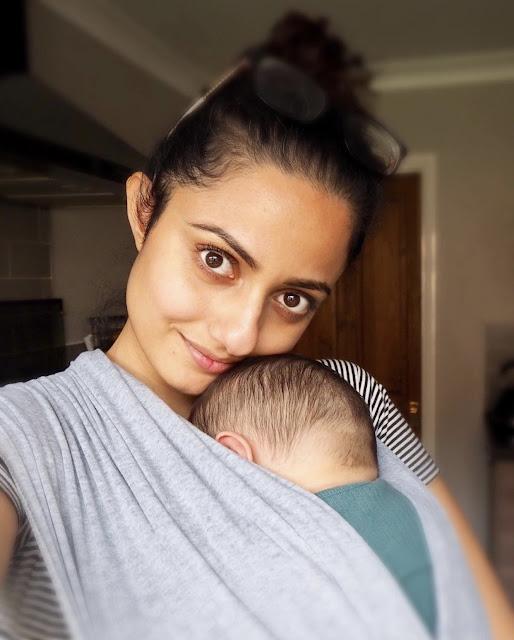 Mum holding baby in sling