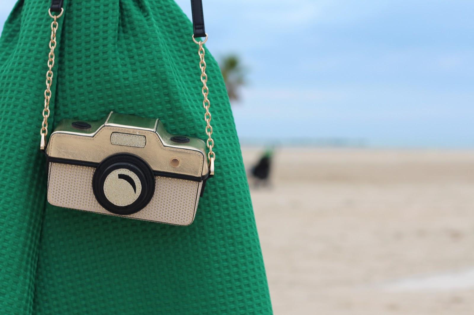 green midi skirt accessorize camera bag