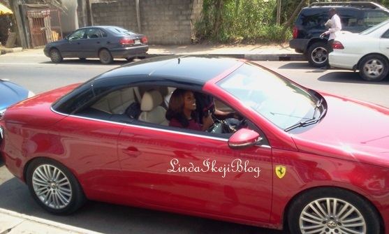 Tiwa savage car a red EOS Volkswagen convertible