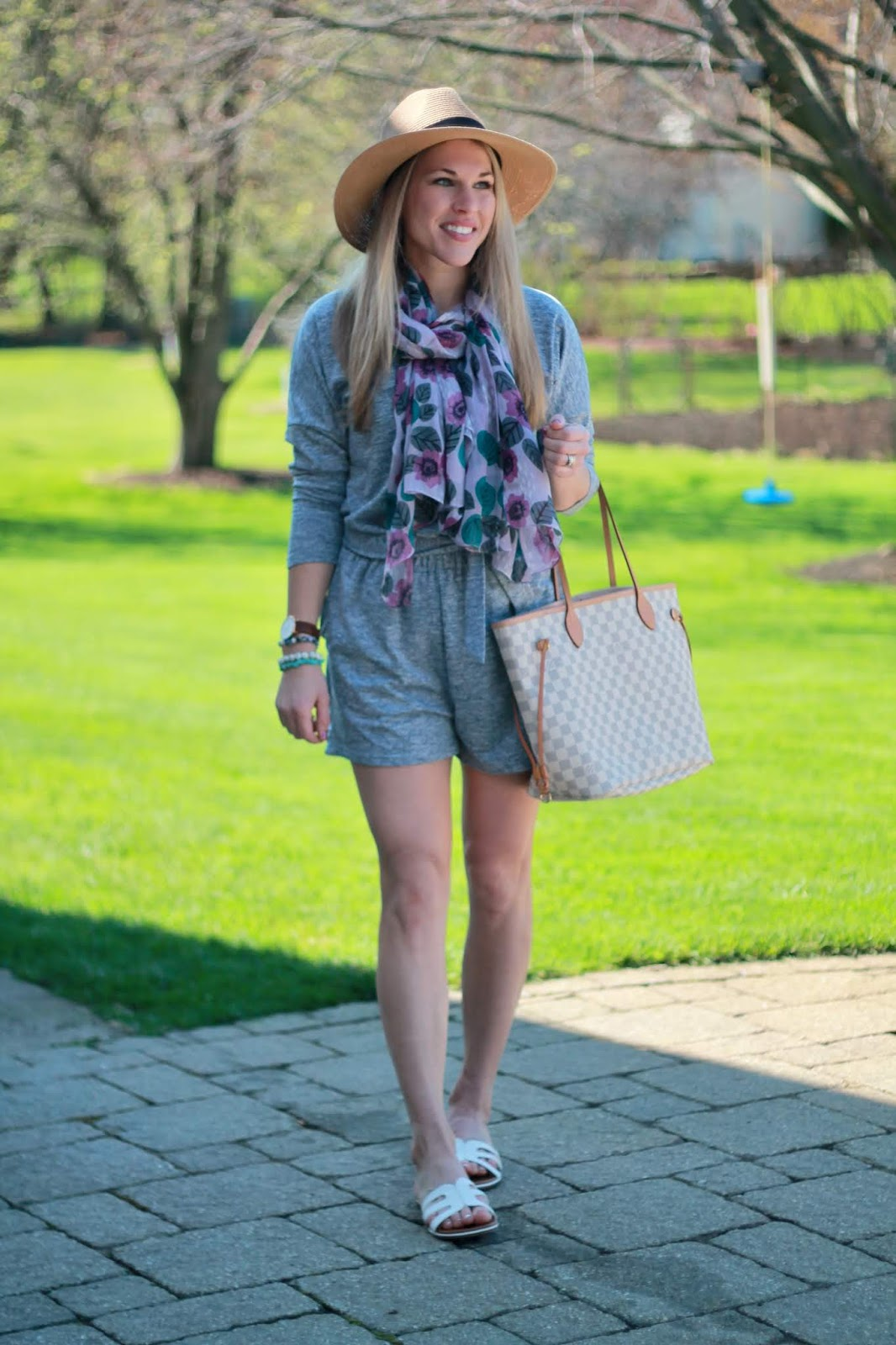 blue long sleeve shorts romper, aventura purple floral scarf, LV azure Neverfull, straw fedora, white sandals