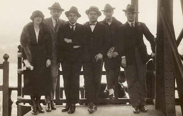 The five members of Les Six who collaborated on Les Mariés, with Jean Cocteau at the Eiffel Tower (1921): Germaine Tailleferre, Francis Poulenc, Arthur Honegger, Darius Milhaud, Jean Cocteau, Georges Auric (left to right)