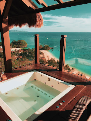 Picture of a hot tub with clam water in room looking out to the beach: Spa's: Don't Take The Dangers for Children Lightly