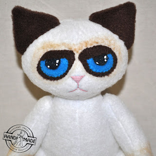 сердитый кот игрушка