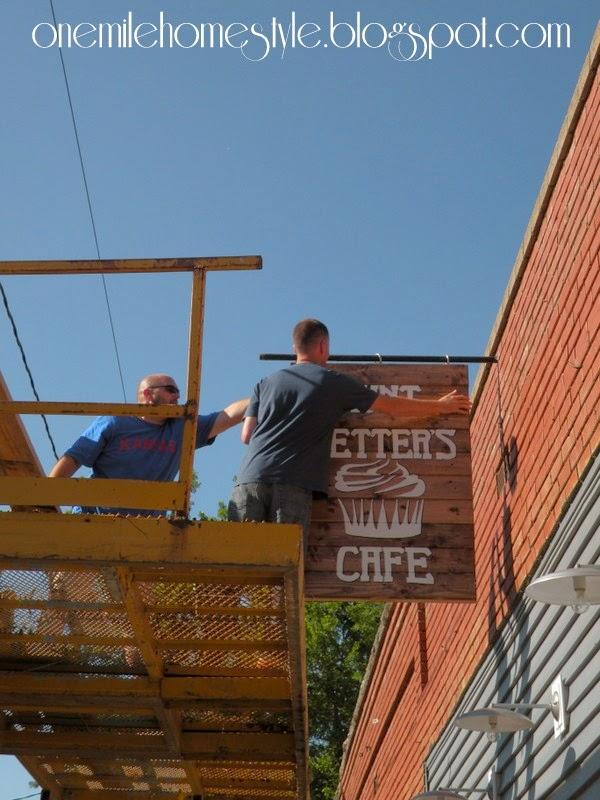 Hanging the Cafe Sign - Aunt Netter's Cafe