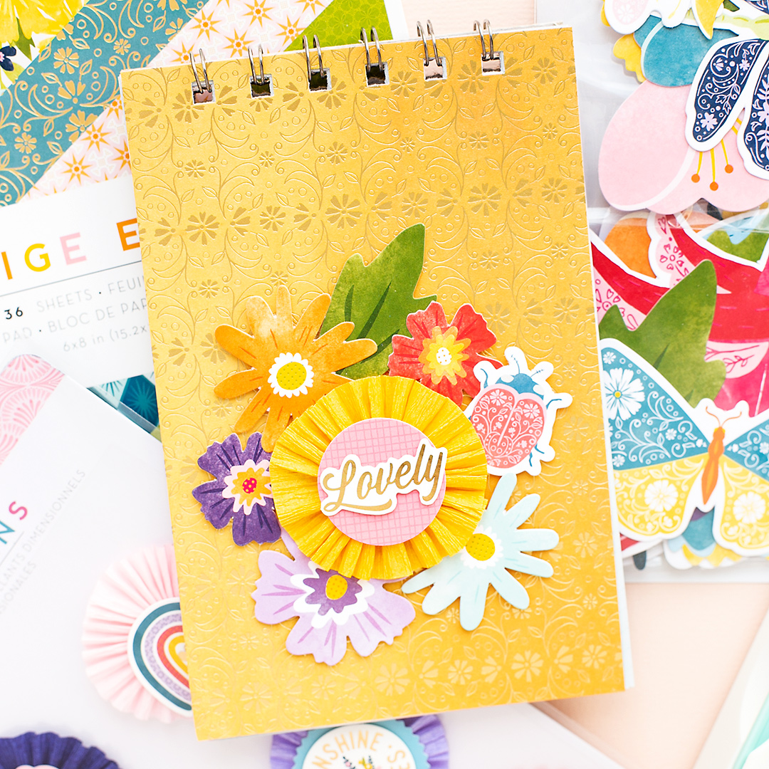 Mini Album with spiral binding and lovely embellishments from the Wonders Collection by Paige Evans American Crafts