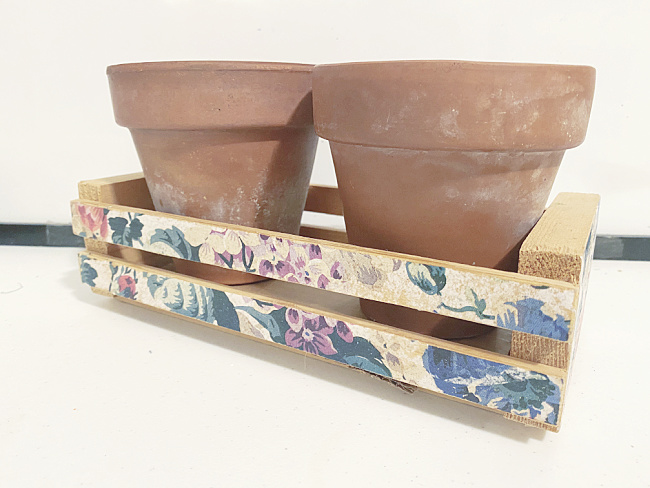 floral crate with 2 terra cotta pots