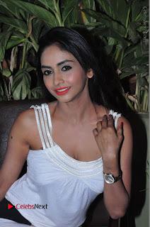 Actress Model Pooja Sri Stills in White Short Dress at F Club pre soft Launch  0081.JPG