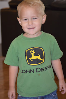 smiling boy in John Deere Tshirt