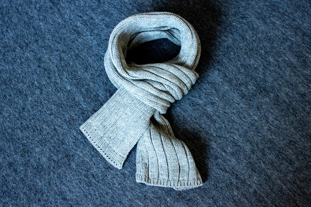 A warm ribbed chunky grey wool scarf from merino wool