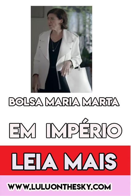 A bolsa da preta e branca da Lília Cabral, a Maria Marta em Império