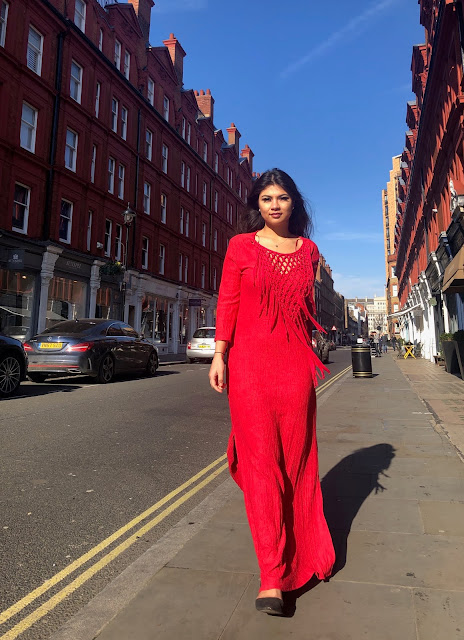 Kelly Fountain wearing a red Zara dress in London England while shooting with Olivia Falcon Tatler Beauty director