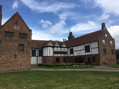 photograph of brick and half-timbered house