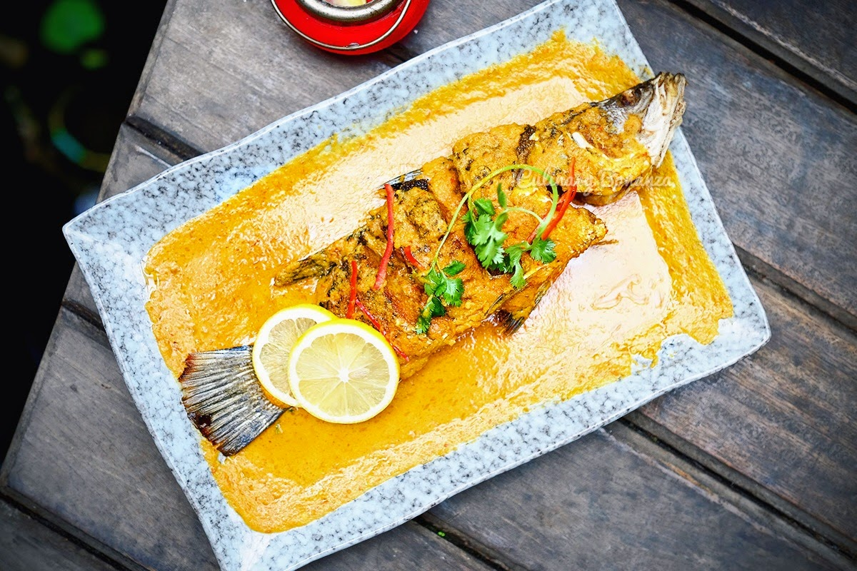 Nyonya Style Fish - fried, whole snapper fish, served with special lemongrass & tamarind gravy