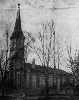 Black and white photo of the exterior of St. George's Anglican Church, built in 1858