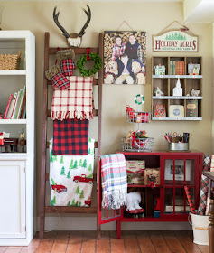 Christmas display in rustic family room with DIY ladder rack and Christmas collectibles