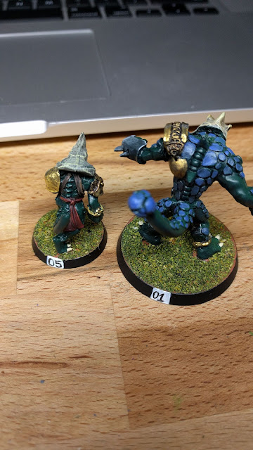 Krox with blue scales next to a Saurus before scaling