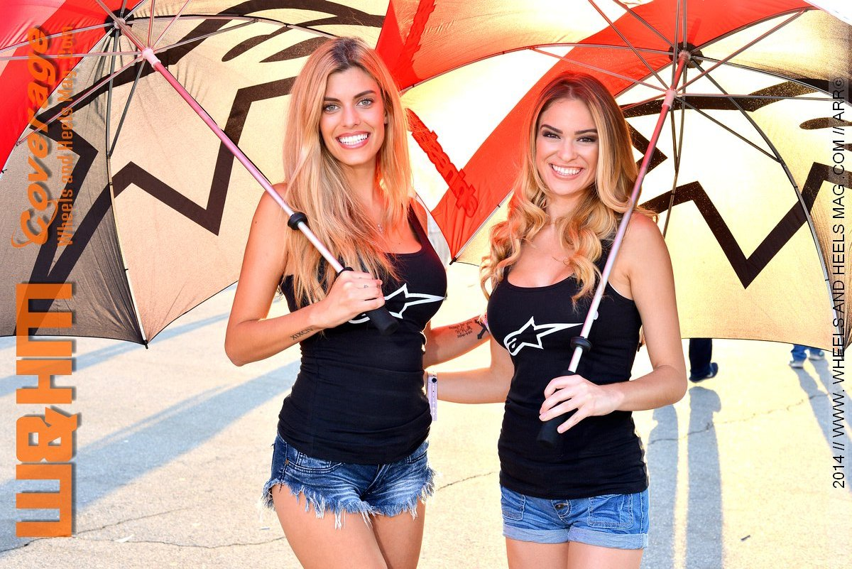 Autumn Allenbach and Daniella umbrella girls car models at Alpinestars in 2014 Formula Drift Irwindale with black tank top and denim shorts