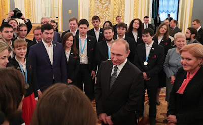 Vladimir Putin and members of WorldSkills-Russia team.