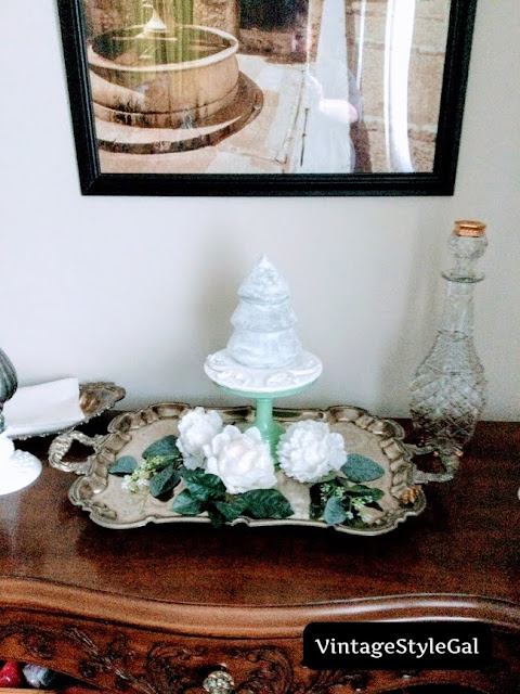 Glass tree covered in epsom salt on cake stand