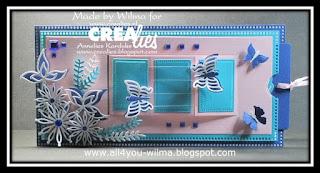 Een slimline pop-up schuifkaart met bloemen, blaadjes en fladderende vlinders op transparante sheet (mica). A slimline pop-up slider-card with flowers, leaves and fluttering butterflies on transparent sheet (mica).