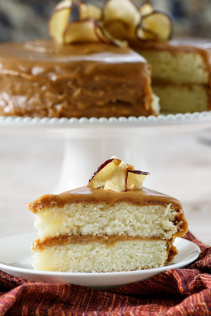 Soft buttery cake loaded with homemade caramel frosting and topped with apple chips. This classic southern caramel cake is great all year long, but we especially love it during fall.