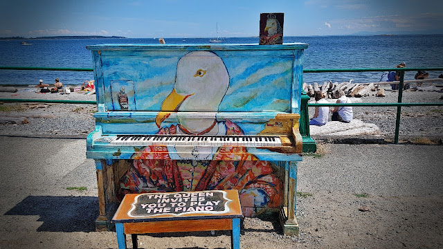 Public piano on the beach at Oak Bay waits to passersby to play...