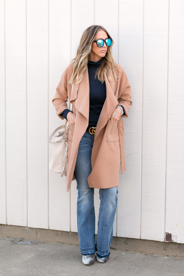 navy turtleneck with tan cocoon coat