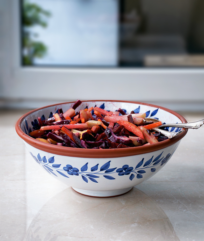 This cold weather vegetable salad is made with apples, beets, cabbage, and carrots. Topped off with an apple cider vinegar and mustard dressing, it's a lightened up winter coleslaw.