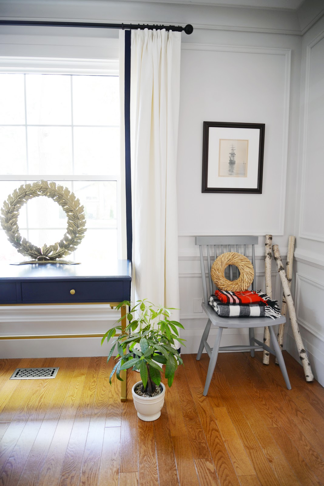 brass wreath, blue desk, and fall accessories