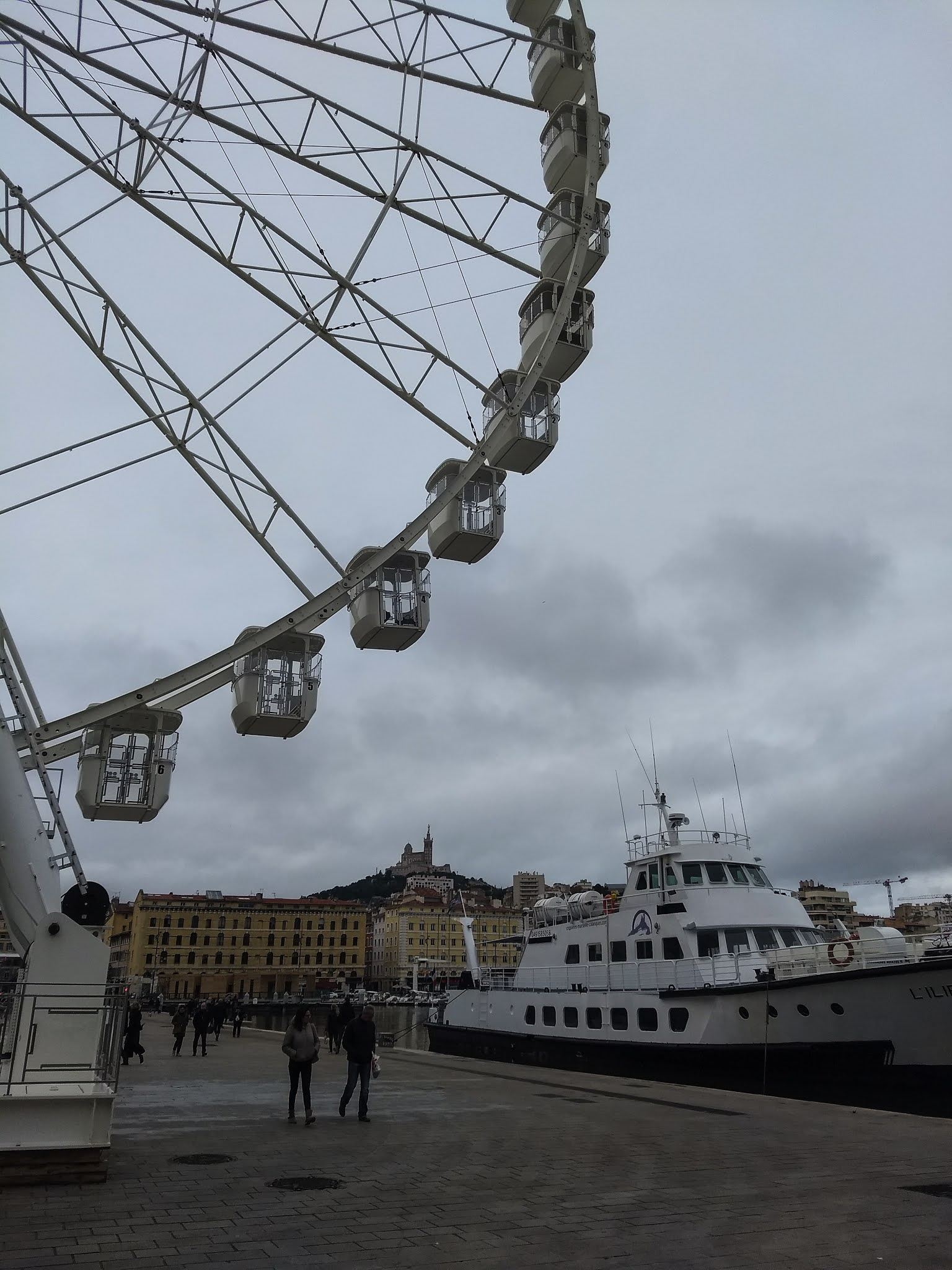 A view of the Big Wheel in the old port of Marseille.