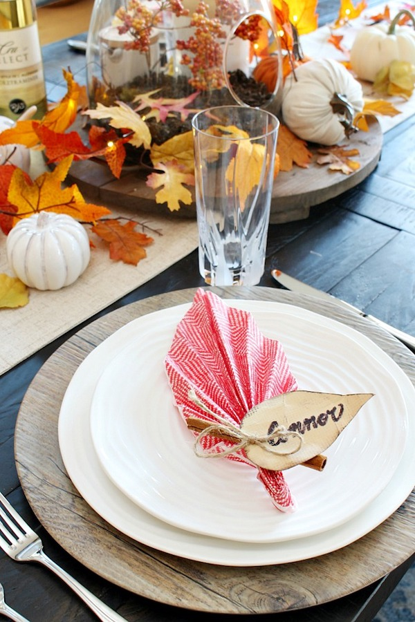 "Thanksgiving table folded napkin with the name tag ""Connor"" on it"