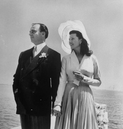 Kahn and Hayworth posing on yacht after 1949 wedding