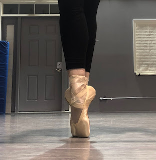 A Ballerina Beautifully Placed in her Pointe Shoes