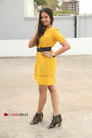 Actress Poojitha Stills in Yellow Short Dress at Darshakudu Movie Teaser Launch .COM 0325.JPG