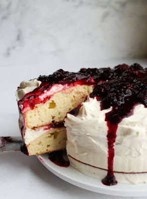 blackberry shortcake cake frosted with ermine frosting and topped with blackberry sauce