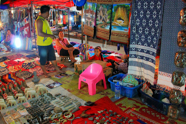 Street vendors at the night market in Luang Prabang