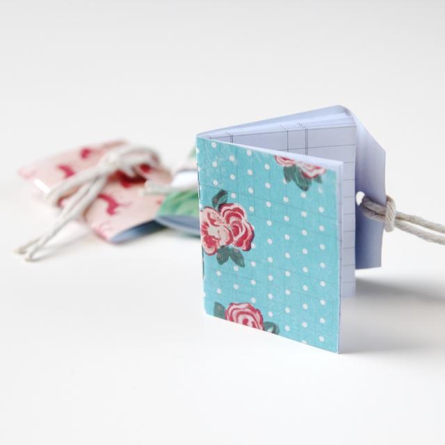 Teeny tiny diy shipping tag notebooks.