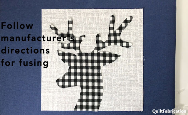 black and white checked deer head on grey background  by QuiltFabrication