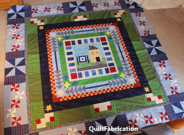 seven different borders on a round robin quilt