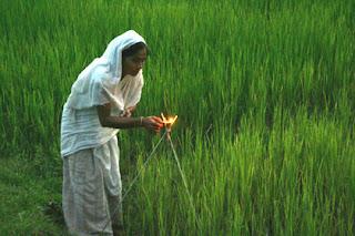 Picture of women lighting a diya