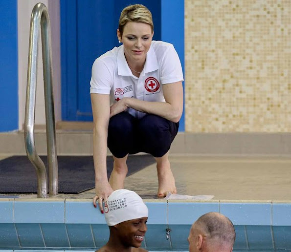 Princess Charlene of Monaco taught water safety and life saving first aid techniques after facing drowning danger to young rugby players who have come to Monaco from South Africa