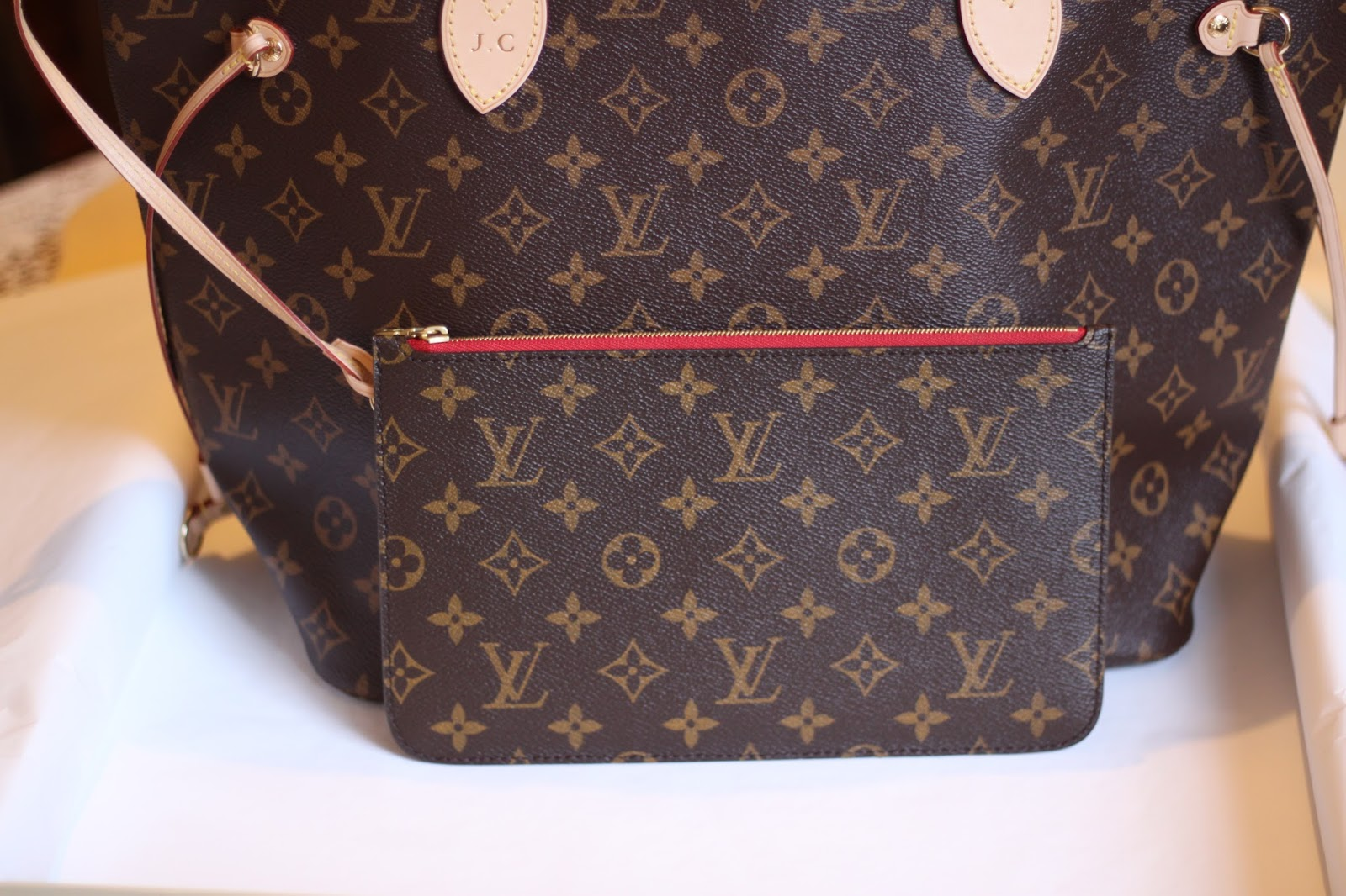 The Louis Vuitton Neverfull MM with attached wristlet