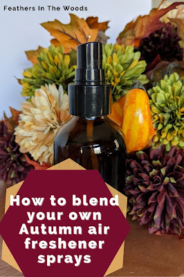 Essential oil room spray in amber glass bottle in front of Autumn decorations