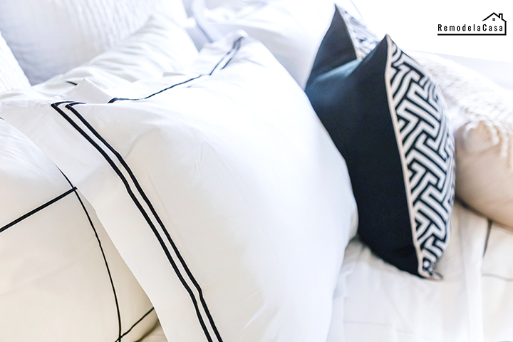 white and black bedding in modern bedroom